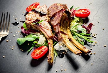 Grilled rack of lamb on slate plate
