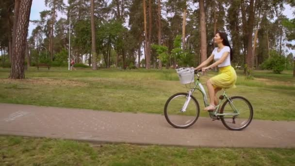 girl riding on bicycle in summer