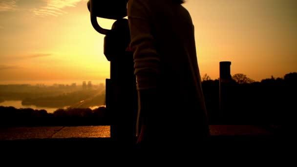lady enjoys sunrise over the city