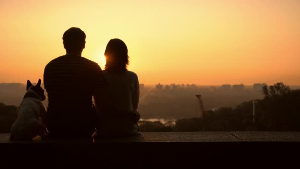 man and woman in love posing outdoors