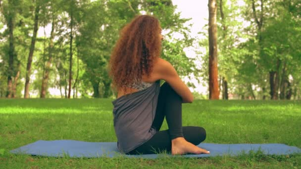 young caucasian girl trains yoga outdoor