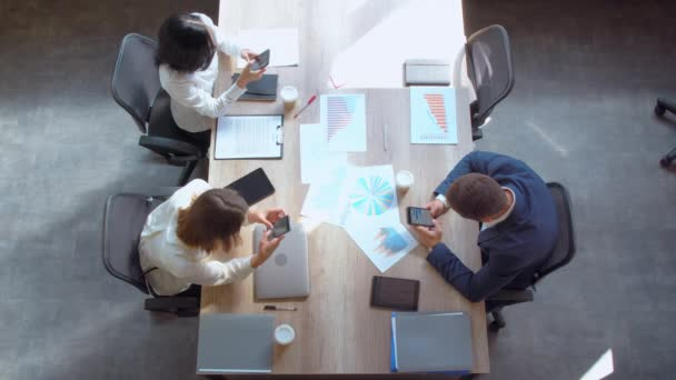workers in startup company sitting in boardroom