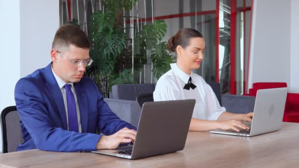 Businessman and businesswoman working with laptop