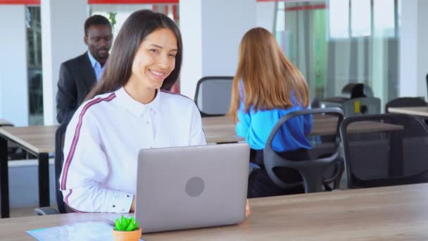 happy manager shows sign ok in open space office worker in start up company
