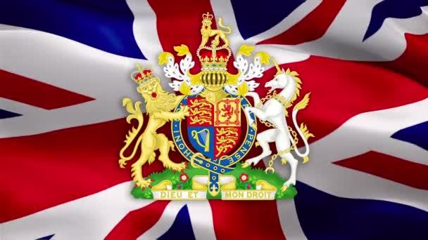 Britská vlajka s královským erbem Spojeného království. Britský královský erb Velké Británie. UK Royal. Britský národní znak Britský znak na vlajce Spojeného království Pozadí-Londýn, 1. května 2020