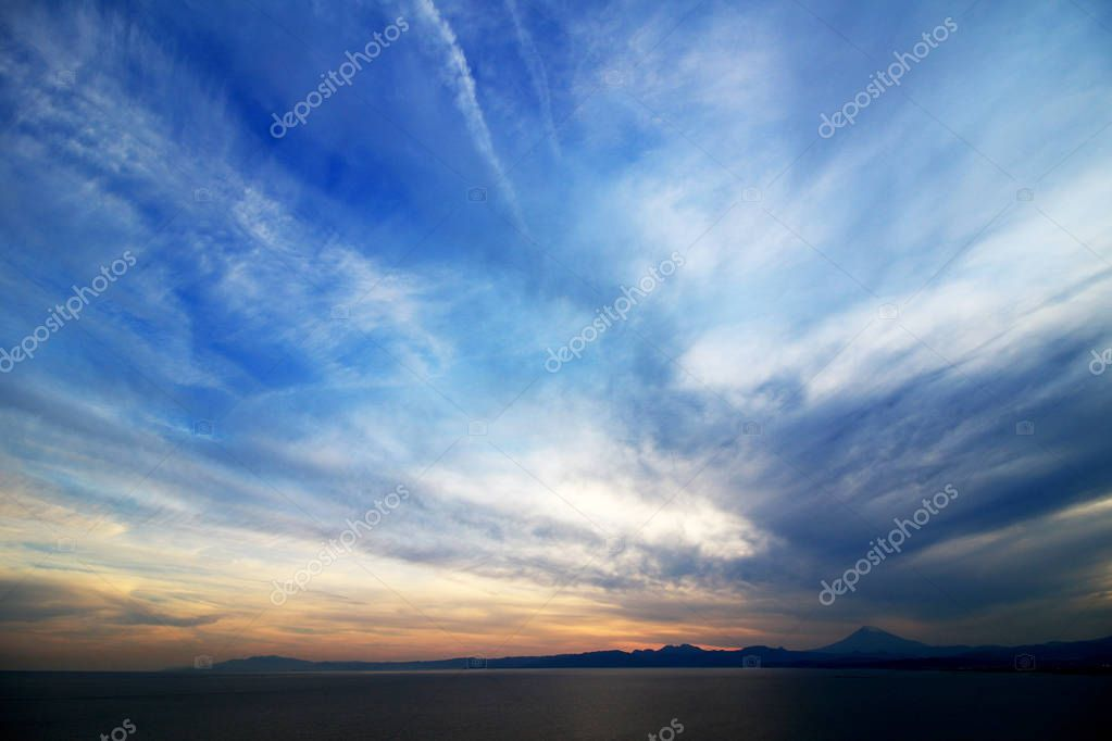 The vast sky at dusk and Mt. Fuji seen far away