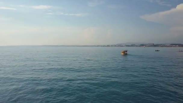 The flight of the drones following the boat to the sea. In the distance you can see the shore.