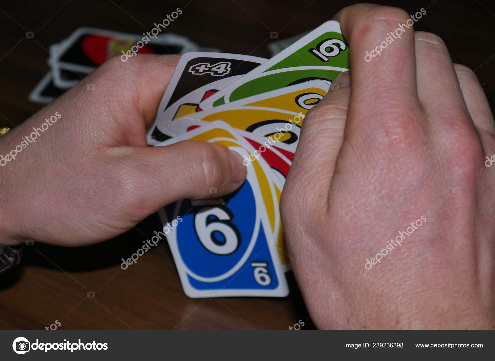 Uno cards in hand, card game — Stock Photo © Egor_1896
