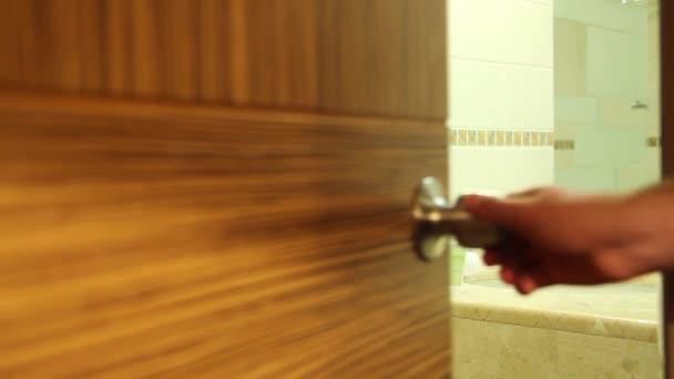 young man opened hotel bathroom door