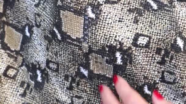 Texture  close up, embossed under skin python, background.Female hand strokes a beautiful Snake skin, luxurious