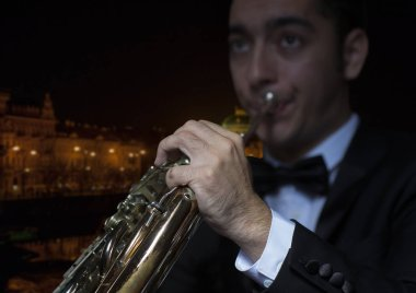 French horn player. Hornist playing brass orchestra music Close-up
