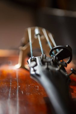 violin in vintage style on wood background close up