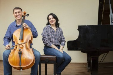 Musicians of the symphony orchestra. Cellist and pianist