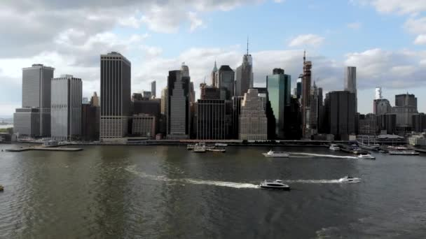 Stunning aerial view of Manhattan Skyline, New York, USA. Panoramic Skyline with skyscrapers and financial district and Hudson river from Brooklyn pier