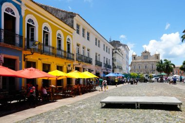 Colorful colonial houses at the historic district of Pelourinho. The historic center of Salvador, Bahia, Brazil. Historic neighborhood famous attraction for tourist sightseeing, little shops and restaurant.
