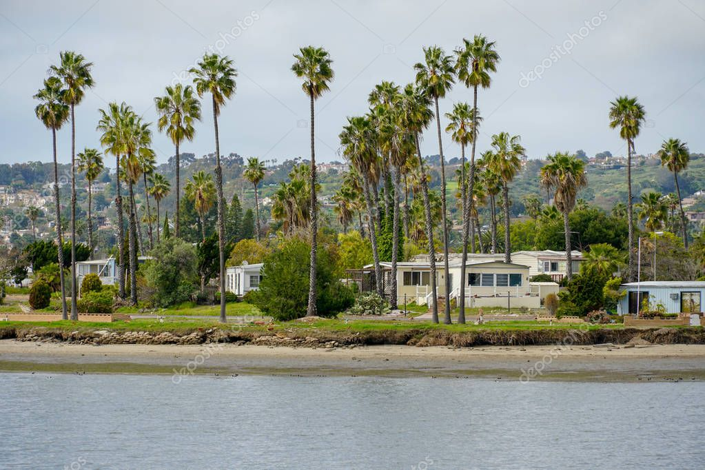 Caravan and home trailer park area next the water in the De Anza Cove in Mission Bay area in San Diego, California, USA.