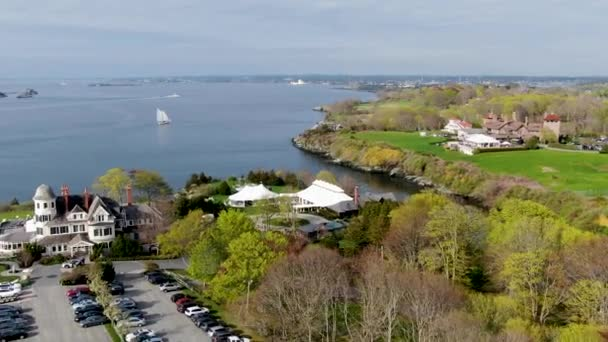 Aerial view of Castle Hill Inn beachfront luxury hotel with wedding reception ceremony setup in the garden, Newport, Rhode Island, USA.