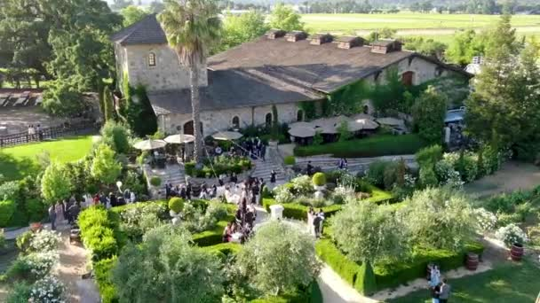 Aerial view of V. Sattui Winery and retail store, St. Helena, Napa Valley, California, USA. People enjoying drink and wedding event in the green garden surrounded by vineyard