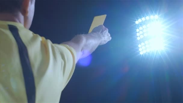 Football soccer referee shows penalty yellow card