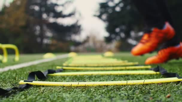 Soccer agility training equipment. Professional football player with an agility ladder. 4k slow motion