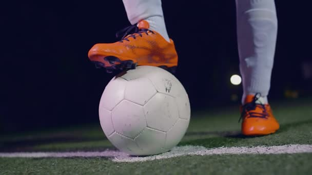 Professional soccer player putting his boot on the ball, 4k slow motion