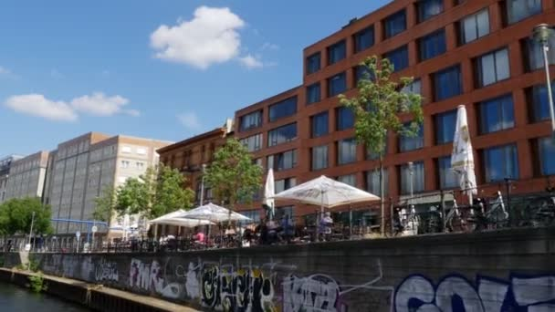 People and buildings along the Spree river in Berlin, Germany. Summertime. 4k