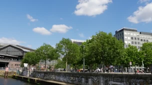 View to Berlin Friedrichstrae station from a boat on Spree river, 4k