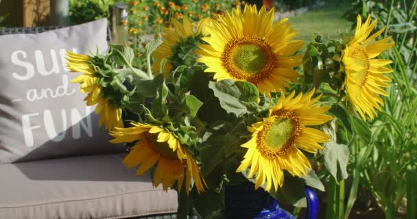 A bouquet of beautiful yellow sunflowers in a vase outdoors, 4k