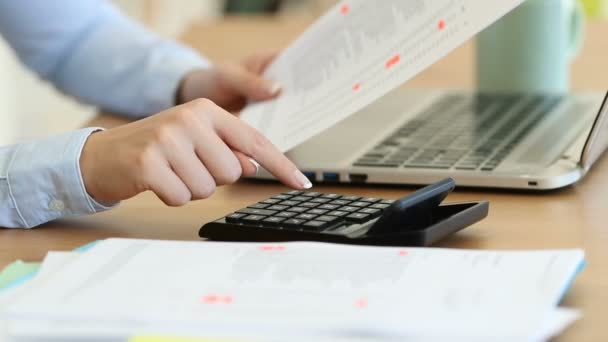 Close up of an accountant hands calculating with a calculator on a desk