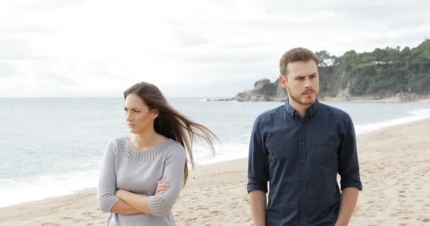 angry couple friends walking argument ignoring each other beach