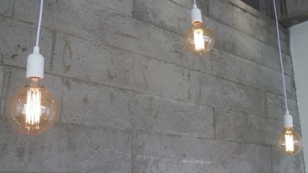 Triple vintage retro hanging light bulbs, stock footage