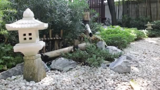 Bamboo flowing water decorated in zen garden, stock footage