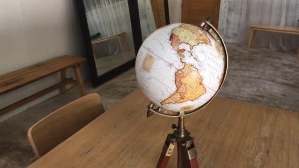 Vintage globe on wooden table, stock footage