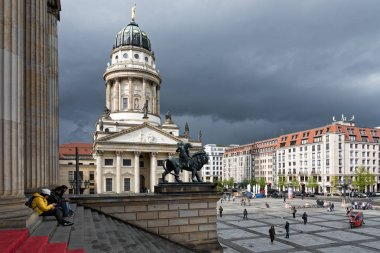 View of the Gendarmenmarkt Square with part of the French Church on April 15, 2017 in Berlin, Germany