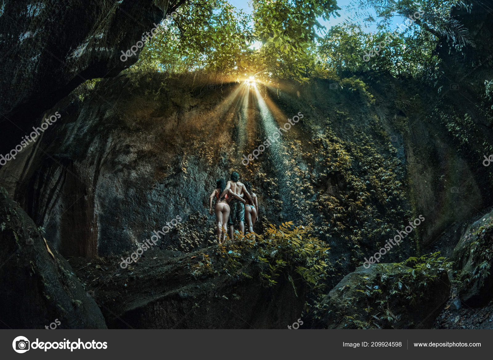 Three Persons Cave Two Girls One Man Standing Big Stone Stock