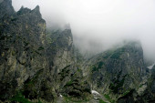 Photo                  The peaks of the High Tatras with white clouds. Mountains in the clouds. High Tatras Mountains in Slovakia