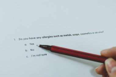 Survey question whether responded has any allergies, including metals, soaps, cosmetics, or alcohol. Choice: yes. Closeup