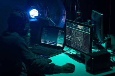 Hackers making cryptocurrency fraud using virus software and computer interface. Blockchain cyberattack, ddos and malware concept. Underground office background.