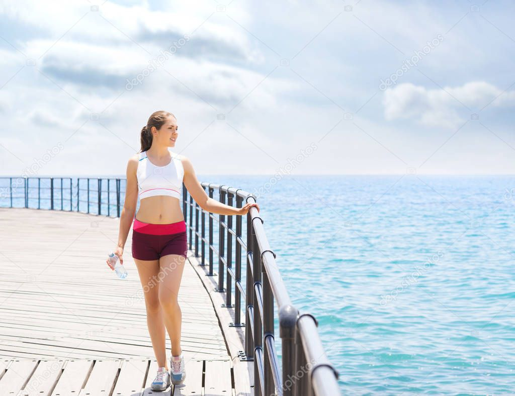 Sport and fitness concept. Young, fit and sporty woman working in a gym outdoor.