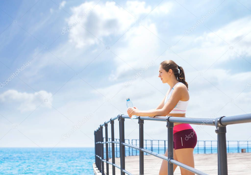 Sporty and beautiful girl doing sports outdoor. Gym, fitness, healthy lifestyle concept.