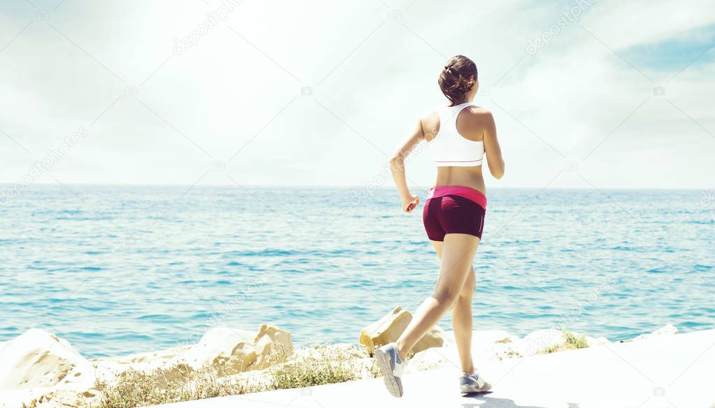 Sporty and beautiful girl doing sports outdoor. Gym, jogging, fitness, healthy lifestyle concept.