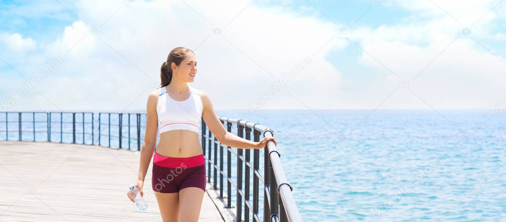 Young, fit and sporty girl training in outdoor gym. Fitness, sport and healthy lifestyle concept.