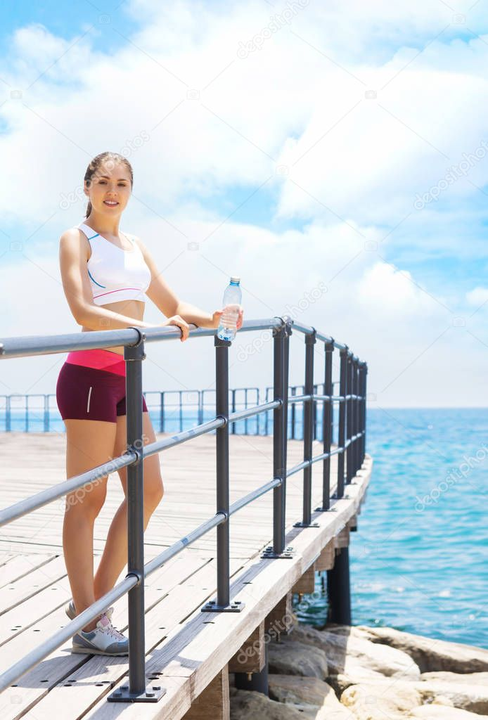 Young and sporty woman training in outdoor gym. Fitness, sport and health care concept.