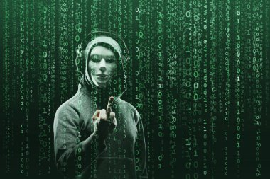 Anonymous computer hacker over abstract digital background. Obscured dark face in mask and hood. Data thief, internet attack, darknet fraud, dangerous viruses and cyber security concept.