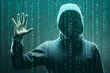 Computer hacker in mask and hoodie over abstract binary background. Obscured dark face. Data thief, internet fraud, darknet and cyber security concept.