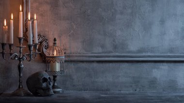 Mystical Halloween still-life background. Skull, candlestick with candles, old fireplace. Horror and witchery concepts.