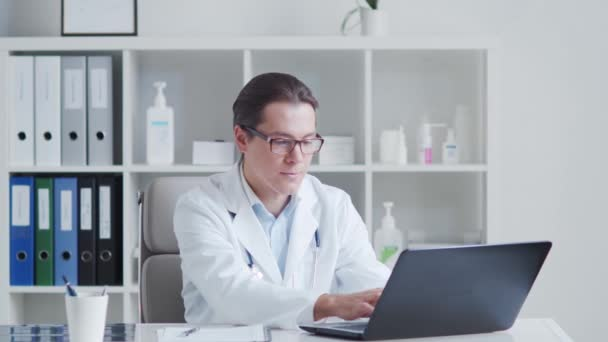 Professional medical doctor working in hospital office using computer technology. Medicine and healthcare concepts.