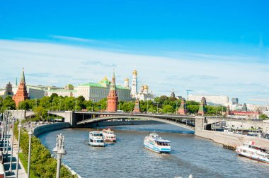 Moscow cityscape with Bolshoy Kamenny Bridge and Moscow Kremlin in the distance