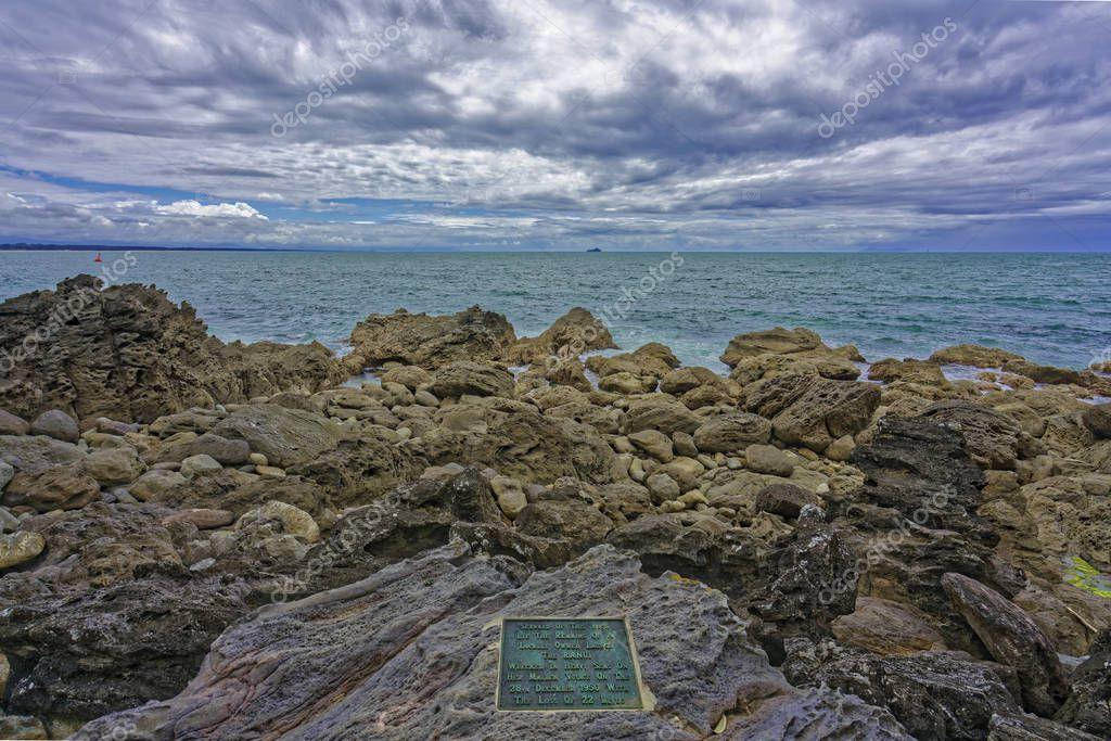 Tauranga, New Zealand - January 15, 2018: Plaque in rock formation, mount maunganui