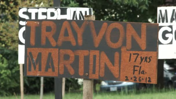 Close up on sign with Trayvon Martin sign and zoom out on other Black Lives Matter victims including George Floyd.